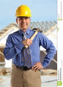 free house blueprints construction foreman smiling royalty free stock image