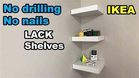 photo wall hanging ideas ikea lack shelf no drilling no nails on wall