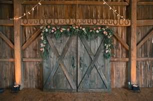 wedding fund registry rustic barn door ceremony backdrop