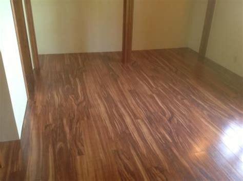 pergo flooring koa laminate wood flooring xp hawaiian curly koa 10 mm h x 4 7 8 in w x
