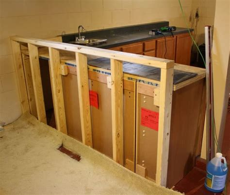raising kitchen base cabinets base cabinets into bar side and built a top out of