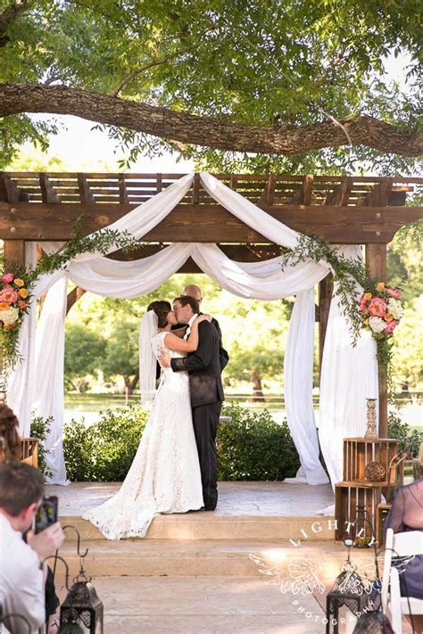 ceremony the pergola with bright summer flowers photographer lightly venue