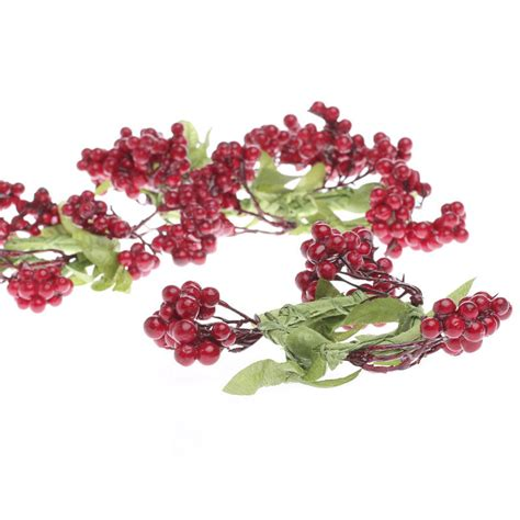 red artificial berry and leaf napkin rings candles and