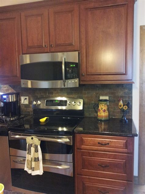 cherry cabinets brown granite counter copper rust