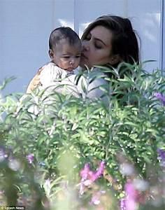 Kim Kardashian dotes on her baby girl North during family ...
