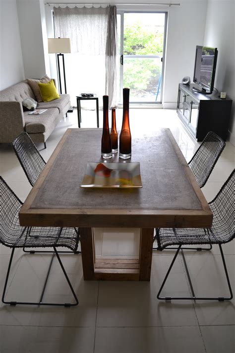 concrete dining table concrete  reclaimed wood table