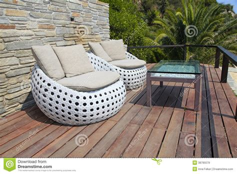 white outdoor furniture on wood resort terrace stock photo