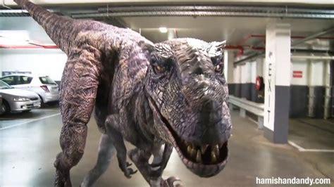 pranksters scare workers  realistic dinosaur