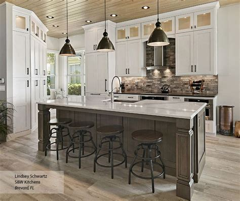 island for kitchens glass inserts in stacked cabinetry provide a beautiful 1942