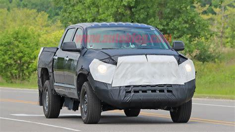 toyota tundra hybrid spied  hiding  rear suspension autoblog