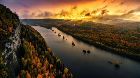 Aerial View Of River And Forest With Background Of Sunset ...