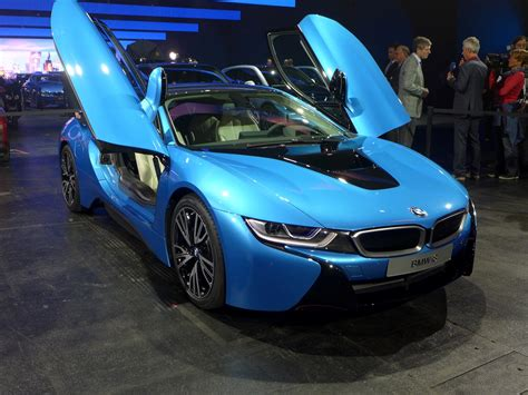 Protonic Blue Bmw I8 Luxury Two Seater Car With Open Door