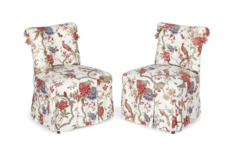 a pair of ground floral chintz upholstered slipper