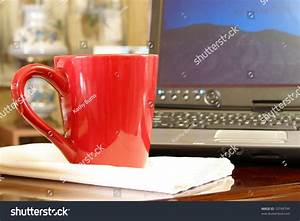 Cup, Of, Coffee, On, Desk, Next, To, Laptop, Computer, In, Small, Home, Office, Stock, Photo, 10749799