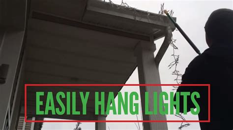 how to put christmas lights on house easily hang christmas lights without a ladder youtube