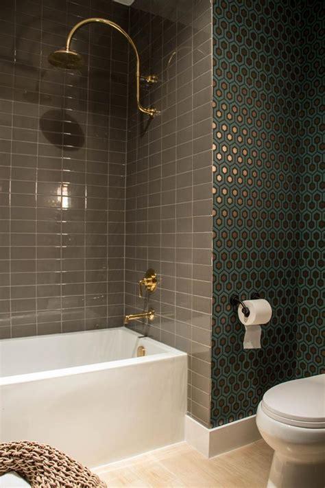 neutral ceramic shower tiles provide  striking