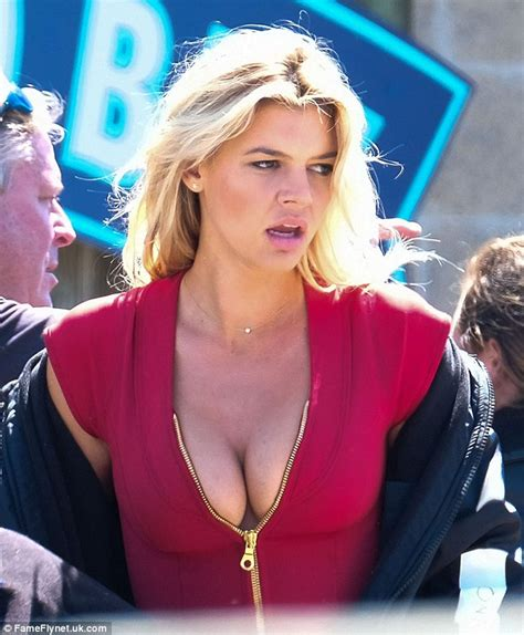 Baywatch's Kelly Rohrbach Flashes Ample Cleavage And Legs