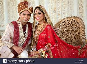 Indian bride and groom in traditional wedding dress ...