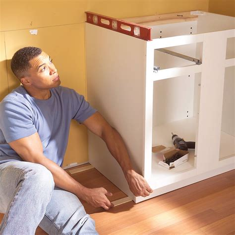 how to install kitchen cabinets do you install kitchen cabinets or floors mail cabinet
