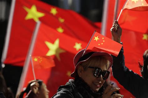 china passes amendments outlawing insulting national flag  seattle times