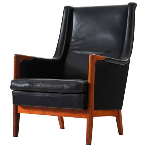 karl erik ekselius high back chair in black leather and