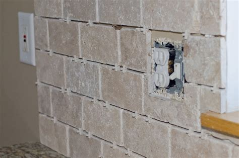 tile and outlet the best way to install wall tile around outlets f r i n g e b e n e f i t s p r o j e c t