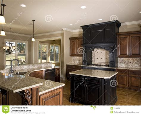 luxury center island kitchen  side royalty  stock