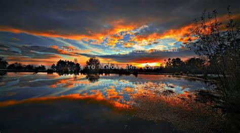 sunset beautiful reflection scenic water