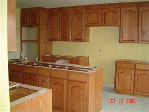Oak kitchen cabinets casual cottage for Oak kitchen cabinet images