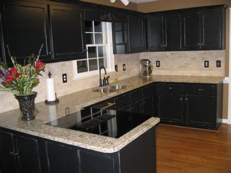 Green Kitchen Walls Brown Cabinets by Black Kitchen Painted Faux Black Cabinets Venetian Gold