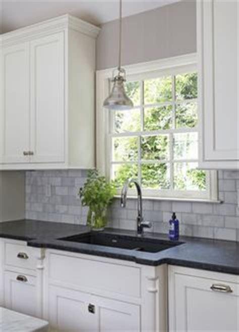surplus kitchen cabinets grey cabinets black appliances silver hardware 2618