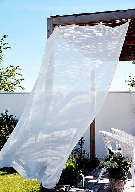 add sheer curtains to your outdoor patio go green