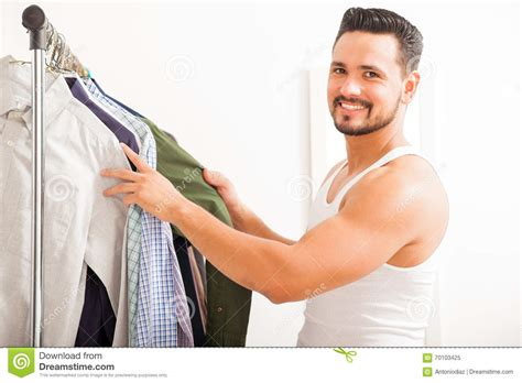 Handsome Man Getting Dressed At Home Stock Photo