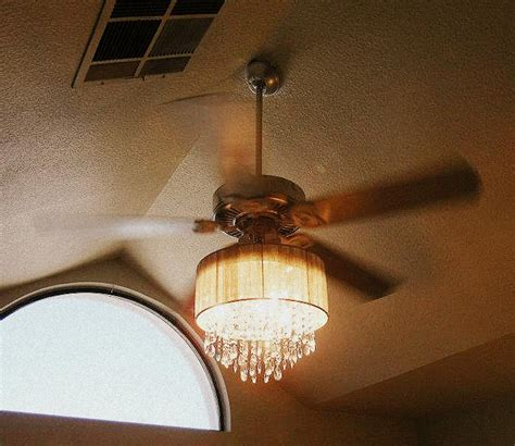 ceiling fan with chandelier for addicted to house redressing and other musings why not a