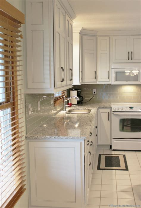 What To Do With White Kitchen Cabinets by White Painted Kitchen With Black Island Home Stores