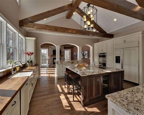 beautiful  tone kitchen  vaulted ceiling beams wood floors wood  granite countertops