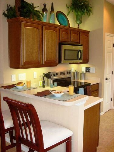 Cabinet Decoration Ideas - 17 best ideas about cabinet top decorating on