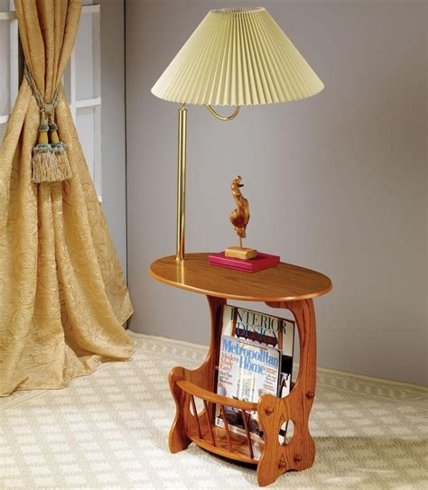 end table with built in l warm oak finish oval end table with brass l and built