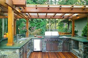 outdoor kitchen with stone cabinets and pergola design With outdoor kitchen designs with pergolas