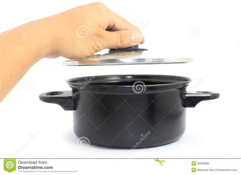 Hand Opening Pot Lid Over White Royalty-free Stock Image