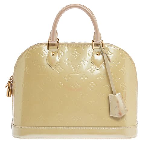 louis vuitton alma pm fuchsia monogram vernis leather handbag english    language