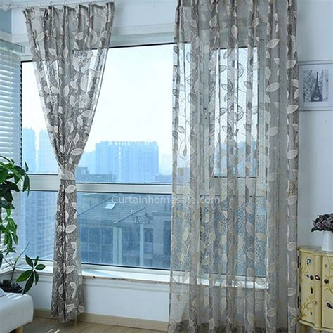 gray sheer curtain patterned with leaves for