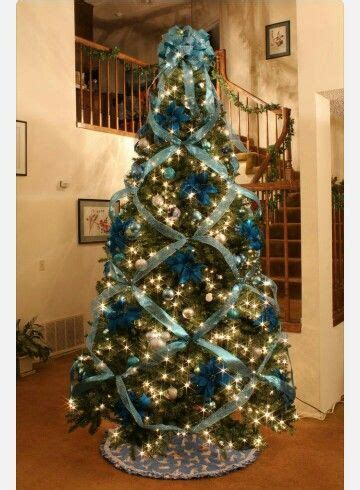 how to criss cross ribbons on a christmas tree the