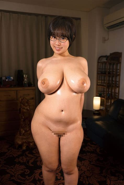 A Short Haired Cute Girl In Glasses With No