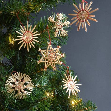 set of eighteen straw christmas tree decorations by winter