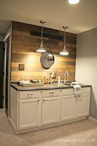 my new favorite wood planked wall from thrifty decor chick With kitchen cabinets lowes with basement wall art ideas