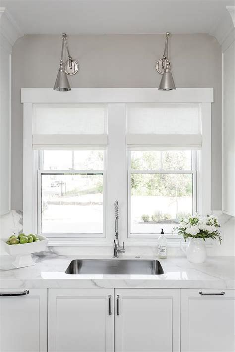 wall light above kitchen sink kitchen window above sink design ideas