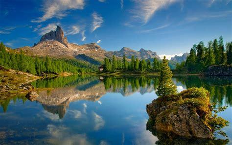 lake dolomites mountains forest mountains reflection