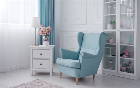 Blue classic armchair and white drawer cabinet with table