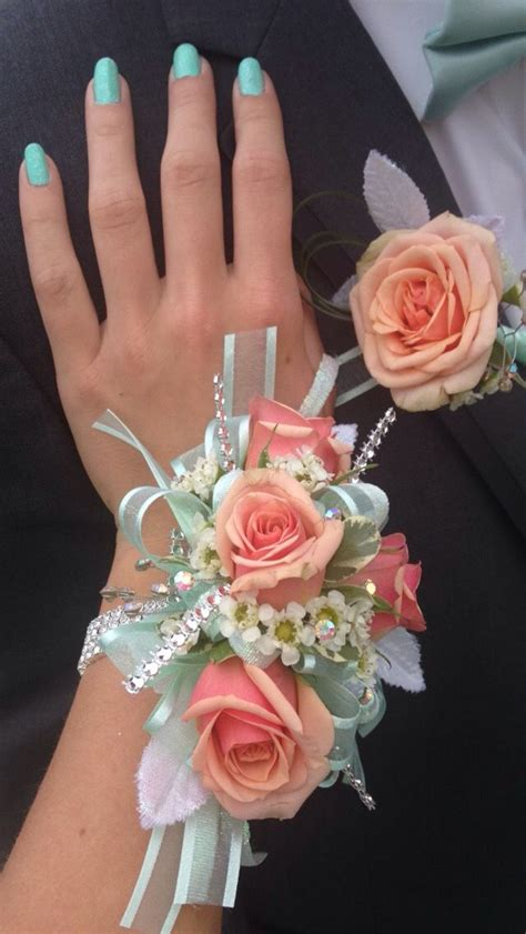 beautiful corsage  matching coral  mint boutonniere
